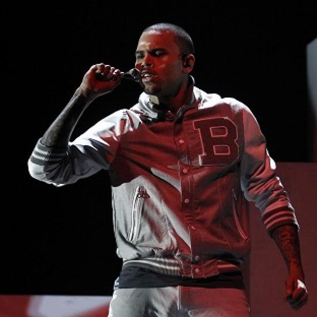 Chris Brown has completed 1,402 hours of community service (AP/Matt Sayles)