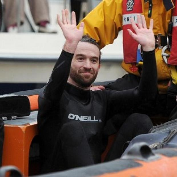 Trenton Oldfield is pulled from the River Thames after he temporarily halted the 158th Boat Race
