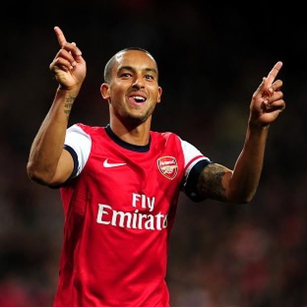 Arsenal's Theo Walcott celebrates scoring against Coventry