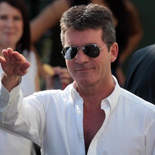 Simon Cowell has defended his decision to use a house healer