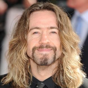Justin Lee Collins denies harassing a former girlfriend