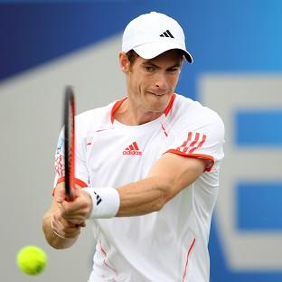 Andy Murray pulled off an easy 7-6 (9/7) 6-4 win to progress in Japan