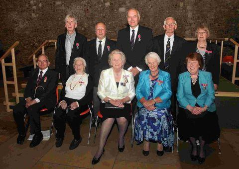 Dame Mary Fagan (centre) with the British Empire Medal Civil Division winners