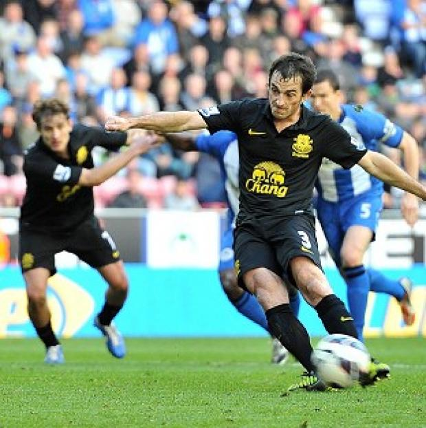 Hampshire Chronicle: Leighton Baines rescued a point as Everton denied Wigan victory