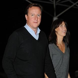 Prime Minister David Cameron and his wife Samantha arrive at their hotel on the eve of the Conservative Party conference in Birmingham