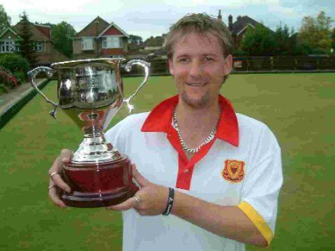 Adam White with the Hampshire two-woods silverware, a trophy donated to the county this season by team manager Derek Collins.