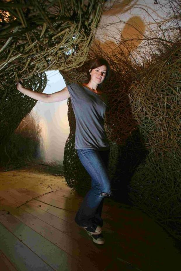 Artist Laura Ellen Bacon with her giant art installation In The Thick Of It: A Woven Space at Winchester Discovery Centre