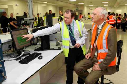 Paper quality and technical manager Paul Rooke showing Sir George Young MP how test equipment operates