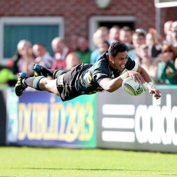 George Pisi dives over for his side's second try