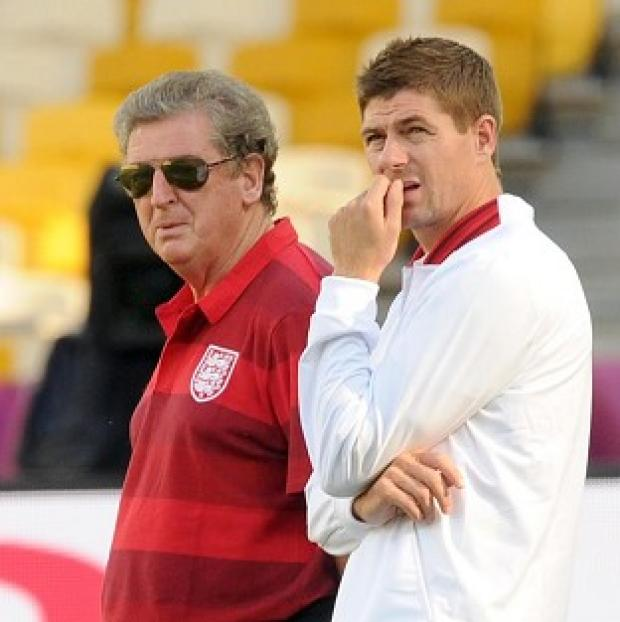 England manager Roy Hodgson is happy at regular captain Steven Gerrard's, right, return
