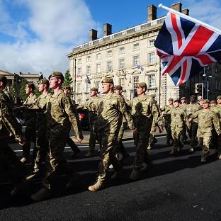 Members of Corunna Company, 3rd Battalion the Yorkshire Regiment, march into Huddersfield for a homecoming parade after serving in Afghanistan