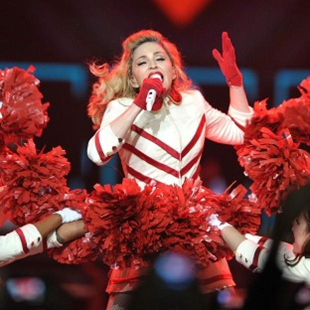 Madonna upset some fans by using guns in her stage routine during a Colorado gig