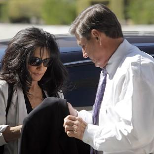 Britney Spears' parents, Lynne Spears, left, and Jamie Spears arrive at court in Los Angeles (AP)