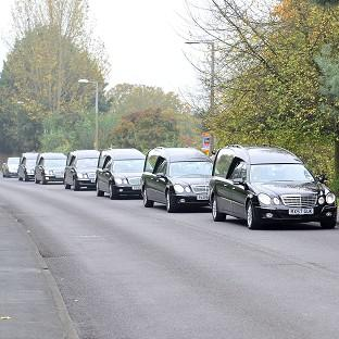 The funeral cortege of a family that died in a house fire in Harlow