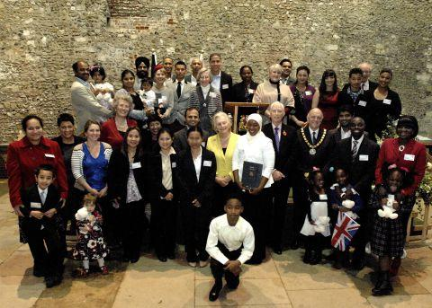 The new British Citizens are welcomed at Winchester's Great Hall