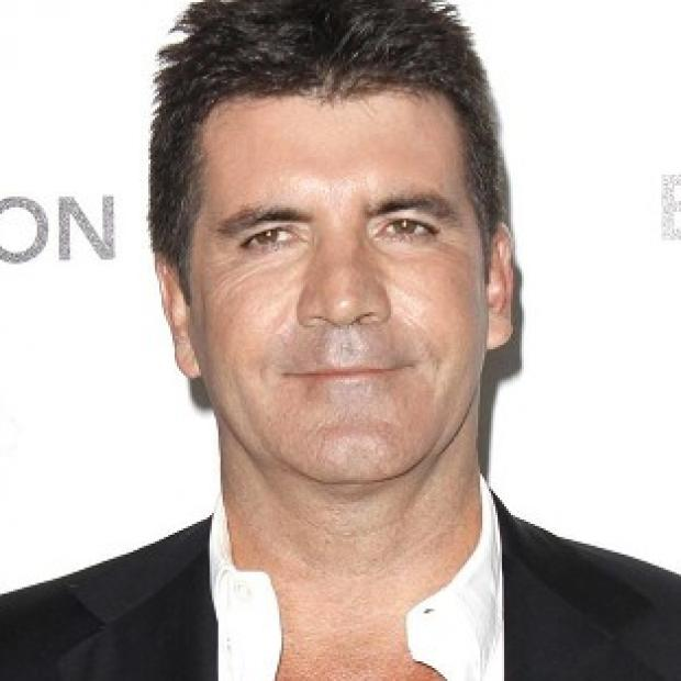 Simon Cowell is reportedly planning to make The X Factor winner's single a charity record this year