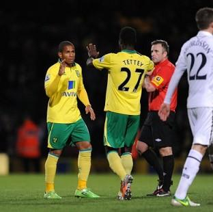 Norwich's goalscorers Simeon Jackson, left, and Alex Tettey celebrate after the final whistle