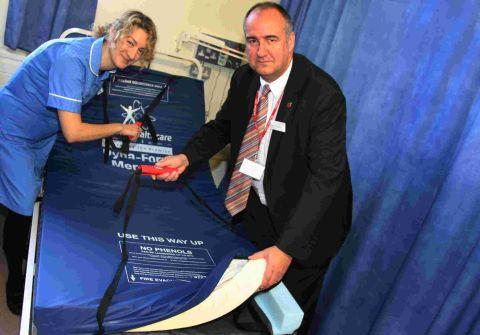 Fire safety officer Steve Tremarco (right) shows Royal Hampshire County Hospital nurse Mahtab Watkins how to operate the mattress