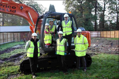 Steve Brine (back right) and daughter Emily, 4, (back left) at Sherborne House school's rebuilding launch