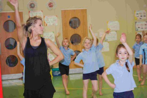 Children at St Swithun's take the lead from Charlotte Bull