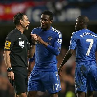 Mark Clattenburg, left, has been accused of making an inappropriate comment towards John Obi Mikel (centre)