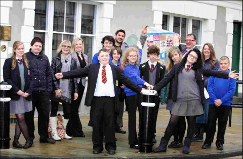 Westgate, Henry Beaufort and Kings' staff and pupils with The Colour Factory's Jenny Muncaster and Rachael Alexander at the bollards in The Square