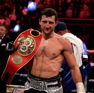 Carl Froch, pictured, retained his title after breaking Yusaf Mack up over three rounds