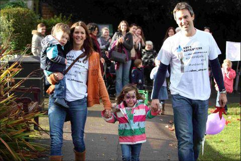 Abe Astur (left) with his mum Leigh, little sister Thea and dad Gavin on the sponsored walk at Abbey Gardens