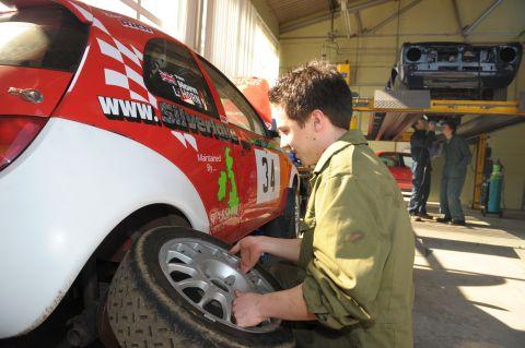 A Sparsholt vehicle student working on a college rally car in one of the workshops that will be renovated.