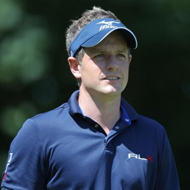 Luke Donald, pictured, is trying to match Rory McIlroy's four wins this season