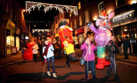 The lantern parade heads down Winchester High Street