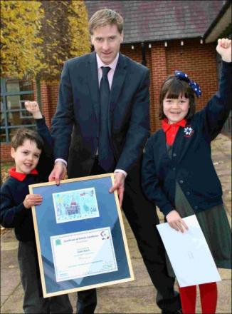 MP Steve Brine with six-year-old winner Liam Skeet and commended Rosalie Upton Jones, seven.