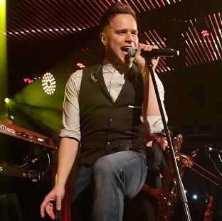 Olly Murs has topped the UK's singles and album charts