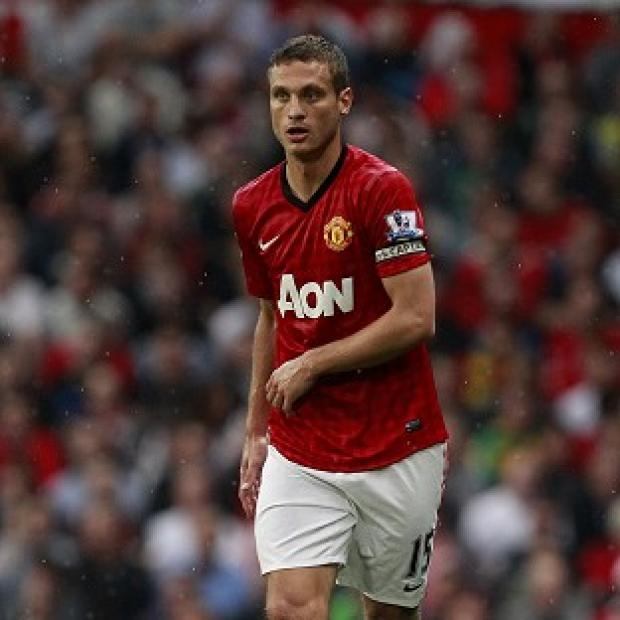 Nemanja Vidic will miss Manchester United's clash with Cluj