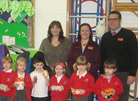 Staff from Sainsbury's visit pupils at Cherbourg Primary School, Eastleigh