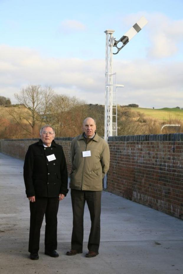 Hampshire Chronicle: Rod Youngman (left) and Chris Pile, of Friends of Hockley Viaduct, by the new signal