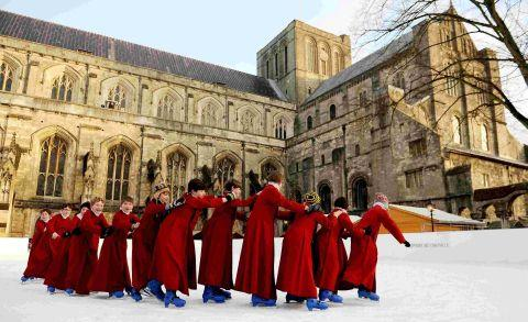 The boy choristers take a break from singing to enjoy the ice. Picture by Andrew Matthews