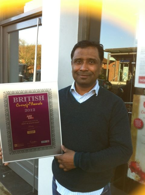 Shafi Hussein with a British Curry Awards certificate