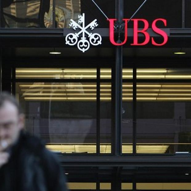The UBS settlement includes a record fine of 160 million pounds from the UK's Financial Services Authority