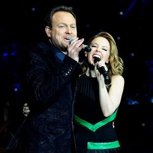 Kylie Minogue and Jason Donovan perform during the Hit Factory Live Christmas Cracker concert at the O2 arena