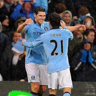 Hampshire Chronicle: Gareth Barry, left, grabbed a vital late winner for Manchester City