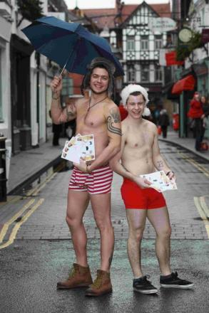 Joe Travis-Deane and Carl Forrest-Jones are down to their boxers to hand out flyers.