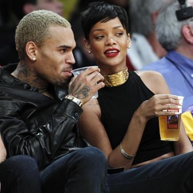 Chris Brown and Rihanna attend an NBA basketball game in LA