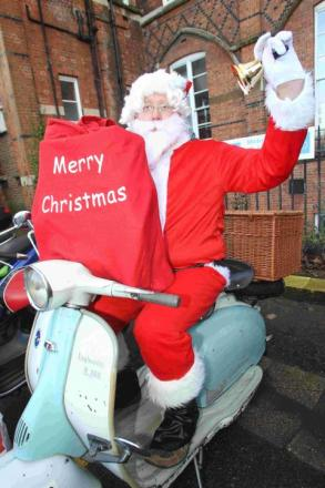 Mark Walker arrives in costume to deliver presents to children at Royal Hampshire County Hospital
