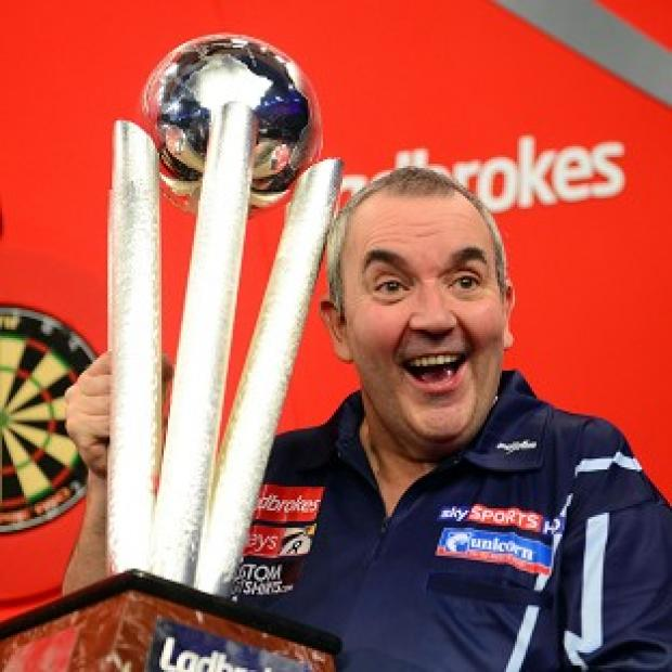 Phil Taylor battled from behind to land his 16th World Darts Championship