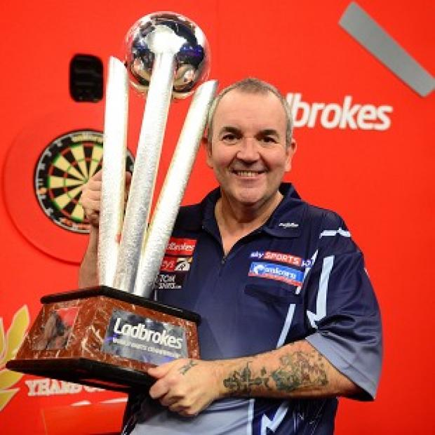 Phil Taylor paid tribute to Sid Waddell after winning a 16th world title