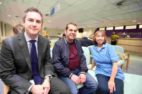 (L-r) Outpatients manager James Montgomery with patient Jason Richardson and nurse Jane Bates