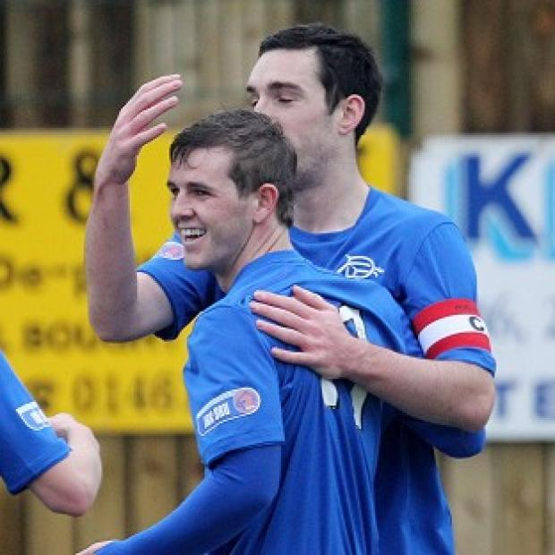 David Templeton, left, celebrates the opening goal