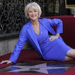 Helen Mirren poses alongside her new star on the Hollywood Walk of Fame