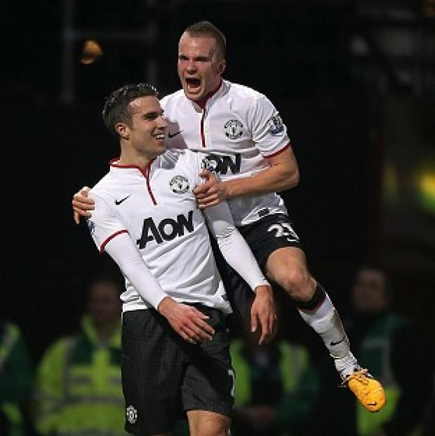 Robin van Persie, left, netted a late equaliser at West Ham to earn Manchester United a replay